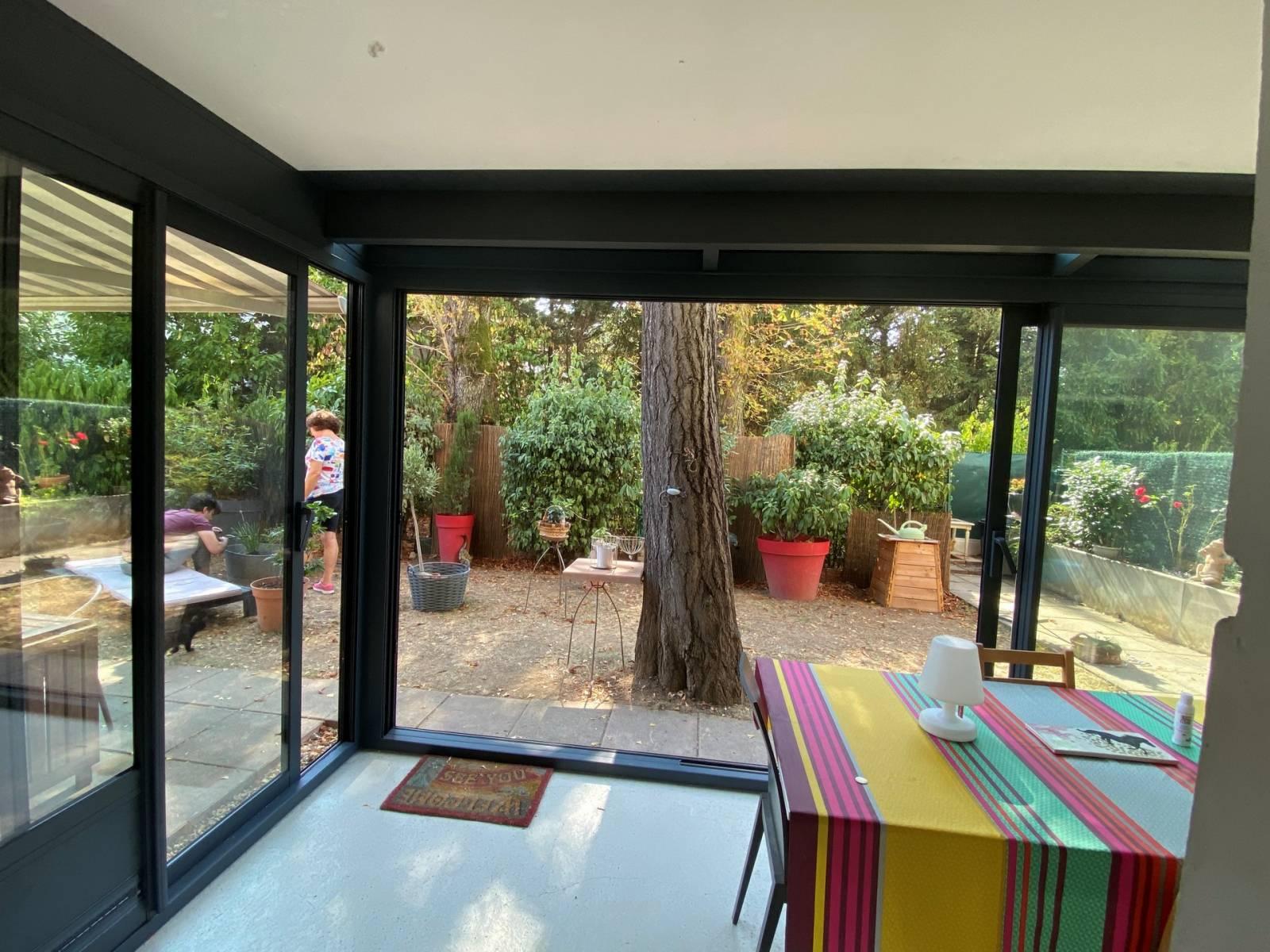 Véranda rez de jardin et balcon réalisée sur mesure dans Lyon - Perspective Véranda